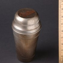 Image of AR_00038 - Tarnished Silver Shaker Cup w/Ovaltine Logo on Cover