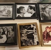 Image of EX_12.13 - Photo - Desi Arnaz kissing Lucille Ball on the cheek and holding Emmy Award