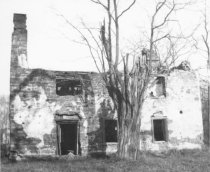 Image of Mouns Jones House, southwest elevation view of surviving eaves wall (1964)