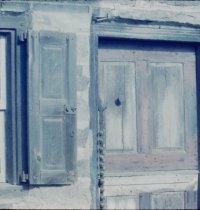 Image of detail view of original door & shutter