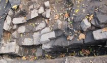 Image of Excavated foundation stones with possible opening for cellar stairs