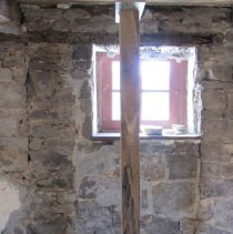 Image of Masonry joints of early doorway; joist leveling-plate above