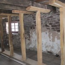 Image of Shoring posts and headers bearing attic joists on laminated sill