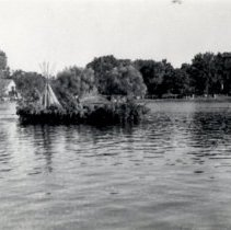 Image of Print, Photographic - 1941 Hutchinson Water Carnival boat parade-Gopher Campfire float