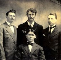 Image of Four men in suits