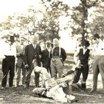 Image of Postcard - Men in shirt sleeves wrestling
