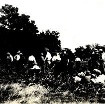 Image of Men and boys with guns in field-postcard