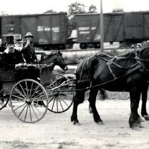 Image of Buggy pulled by team of dark colored horses