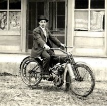 Image of Herman Scheer on his Wagner motorcycle-postcard