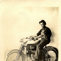Image of Unidentified man on motorized (Wagner) bicycle-postcard