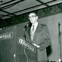 Image of Ray Agnew standing at podium in Miama Beach 1972