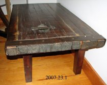 Image of Top of table is the hatch cover from a Liberty ship of WWII