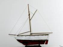 Image of Boat, Pond - Sailboat; red and white hull; no sails.