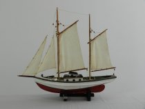 "Image of Boat, Pond - Schooner ""Sea Witch""; white over red hull, two masts and four off-white sails (mains are gaff-rigged); hand built."