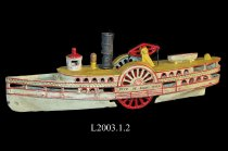 Image of Metal child's model of side wheeler passenger ferry boat.