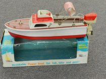 """Image of Boat, Pond - Owner #452-3--""""Lanecraft""""-Sport Cruiser12""""L x 5""""W x 4""""Tall--white over red hull with white cabin.  Red and white striped Bimini Top. Outboad motor. In original box."""