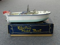"""Image of Boat, Model - Ski Boat--White over Blue Hull with Blue Bimini Top.  Red outboard motor.--12""""L x 5""""W x 5""""Tall. In original box."""
