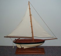 Image of Boat, Pond - Sailboat; green hull with off-white bottom and keel; two white sails.