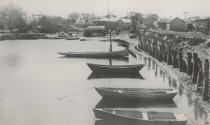 Image of Boats anchored alongside of the Railroad Bridge embankment - W0036