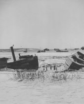 Image of Beached fishing draggers possibly on what was Shirt Tail Point,  Winter 197 - W0044
