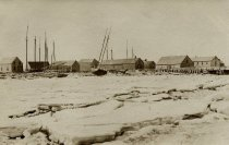 Image of Wellfleet Wharf area; deep winter ice in bay - W0059