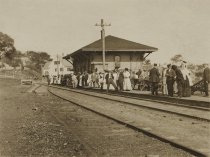 Image of Train station with passengers on platform - W0280