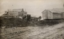Image of Chequesset Inn from Mayo Beach bath houses on the right - W0437