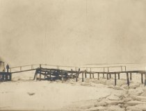 Image of Ice at Chequesset Inn - Feb 12, 1918. John Swett at wharf - W0441