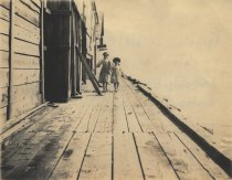 Image of Frolicking on Old Chequesset Inn porch - W0442