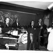 """Image of 1987.14.0826-1987.14.0900 - Louis Armstrong Collection: Photographs, Box 10. """"Louis in Performance."""""""