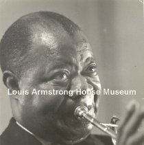 Image of Louis Armstrong playing the trumpet - 1960s