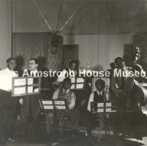 """Image of 2006.1.586--2006.1.660 - Jack Bradley Collection: Photographs, Box 7 """"Louis Armstrong in Radio, Television or Recording Studio."""""""