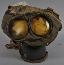 Image of Yellowish lenses of the gas mask