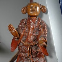 Image of Attendant figure to right of Li