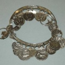 Image of 1896 Erased and Engraved Coin Charm Bracelet
