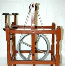 Image of Frontal View of Sifton Wheel & 2 bobbins at upper left