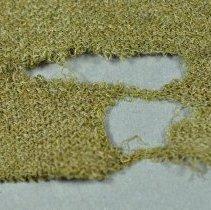 Image of Puttee - Damage detail