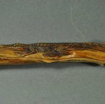 Image of Side view of alligator carving
