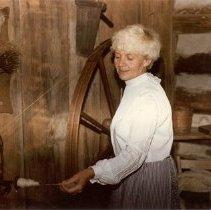 Image of Lillian Langhammer demonstrating the walking wheel (1970s)