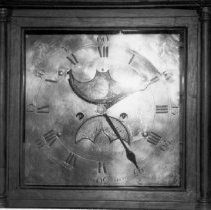 Image of Black and white image of brass clock face area