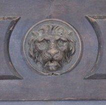 Image of Top of backboard - Lion detail