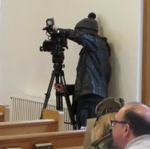 Image of News 9 Camera man, reporting on today's ceremonies.