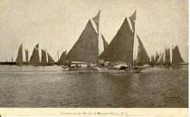 Image of postcard - View of sloops sailing on the river.  Printed in black ink at bottom of card:  Sunrise at the Mouth of Maurice River, N.J.  Reverse of card is addressed to:  Mrs. Sara Husted, Bridgeton, New Jersey.  Message:  Birthday Greeting, John Hanes.  Post date none.