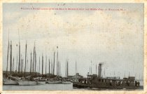 Image of postcard - Tinted photo of oyster boats moored.  Printed in red across top of card is:  Maurice River Cove Oyster Boats Moored for the Week End at Bivalve, N.J.  Steamer ferry boat pictured in foreground. Oyster sheds in background.  Reverse of card has handwritten, in pencil, message:  from a friend you all know well Mr Geo E Pierce Love to you all.  Postmarked Sep 12, 190?.  Addressed to Miss Velmor E Jones RFD No 7, Bridgeton, NJ