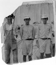 """Image of Print, Photographic - b/w photo of 3 boys; 2 in baseball uniform, one in overalls; aboard schooner.  Caps read """"Gold Medal Flour.""""  """"Some class."""""""