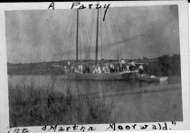 Image of Print, Photographic - b/w photo of Martha Meerwald, sails down, and yawl boat taken from starboard aftin narrow river with dozens of people aboard.  See also 2003.01.0058