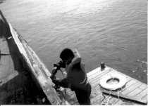 Image of Print, Photographic - b & w photo of Cumberland Day program participant painting and scraping CLYDE A PHILLIPS.