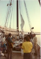 Image of Print, Photographic - Color photo showing Delaware Bay Schooner Project's plank owner's sail aboard PIONEER. Muscians Phil & Ciro LoPinto with brother in law, Ed.  Greg Honechefsky standing far right.