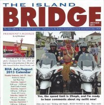 Image of July/Aug issue of The Island bridge.  Includes articles about recent parade, gardens, and the Abrams.  Insert about Camp Tucker.