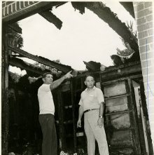 Image of 0120-006_01-09-001 - Irving Warshaw and M.L. Mollica Standing in Burned Building